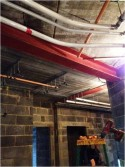 Installation of sprinkler pipework to corridor.
